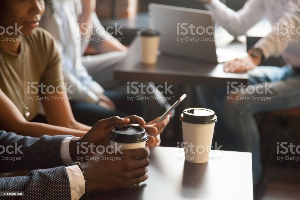 Coffee break in cafe with gadgets concept, diverse young african and...