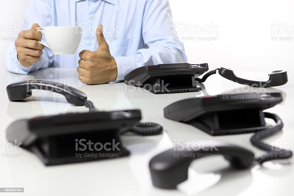 coffee break in the office, like hand , phones off stock photo