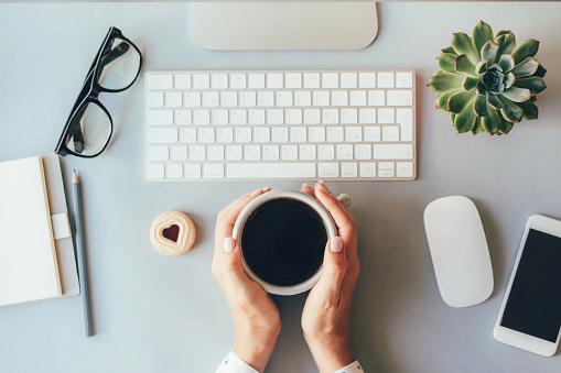 istock coffee break in the office 1160981890