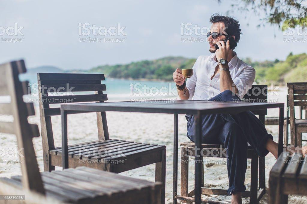 Coffee break on the paradise beach stock photo