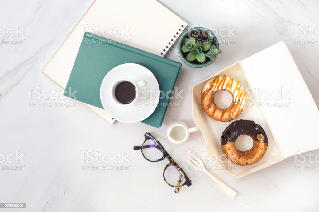 Coffee break time food and drink table top shot. stock photo
