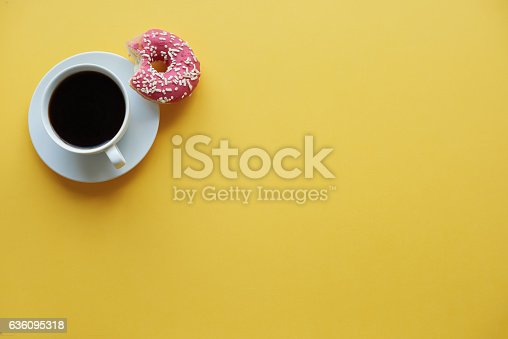 istock Coffee break time with donuts 636095318