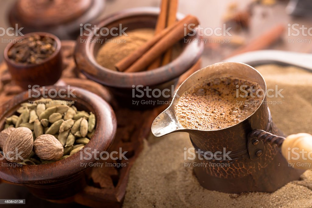 Coffee brewing on hot sand stock photo