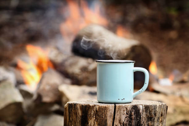 coffee by a campfire - camping stock photos and pictures