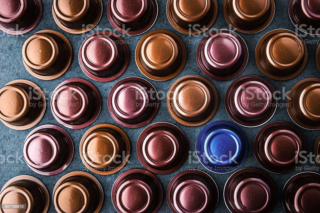 Coffee capsules on the dark table top view stock photo