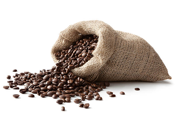 coffee: coffee beans in sack isolated on white background - coffee beans stock photos and pictures