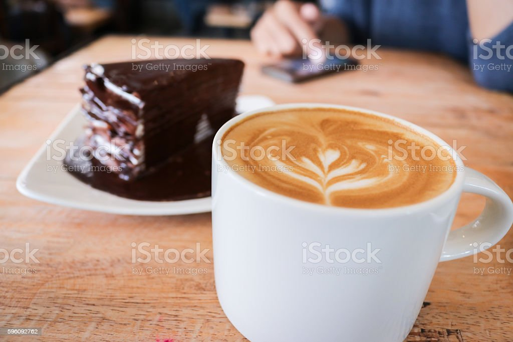 Coffee Coffee cup and chocolate cake on wood table. royalty-free stock photo