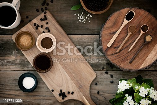 Coffee & coffee beans concept on an old wood background