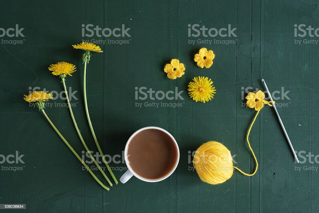 Coffee, crocheting and dandelions royalty-free stock photo