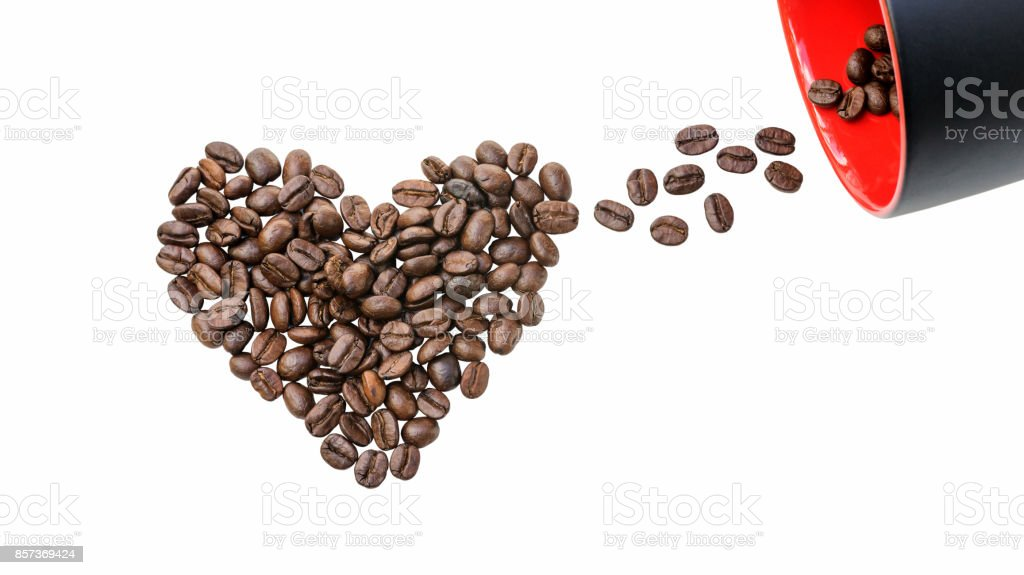 Coffee cup and a heart shaped of coffee bean on a white background. stock photo