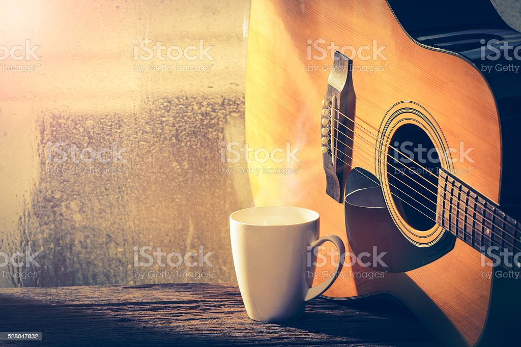 Coffee cup and acoustic guitar stock photo