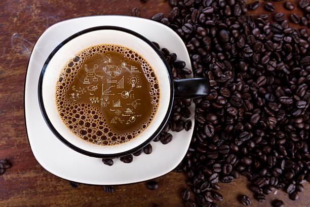 Kaffeetasse und Bohnen mit business-Diagramm – Foto