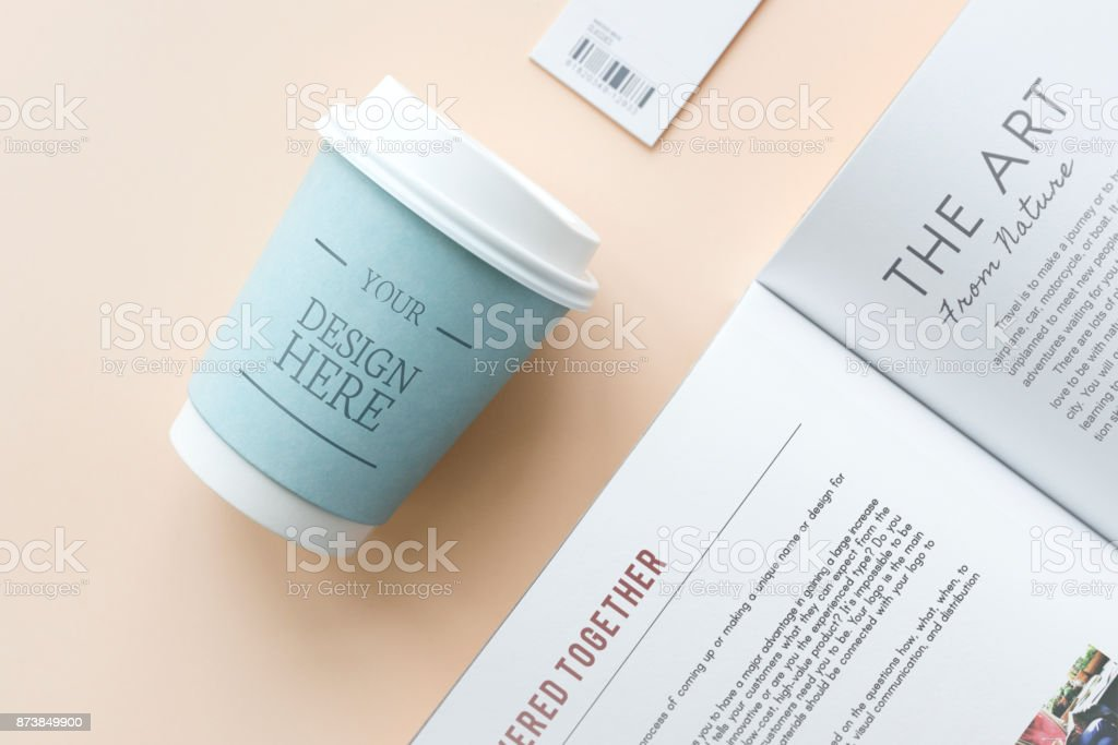 Coffee cup and book mockup stock photo