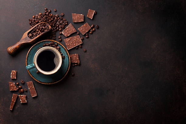 Coffee cup and chocolate on old kitchen table stock photo