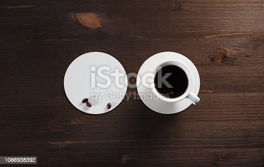 istock Coffee cup and coaster 1066938392
