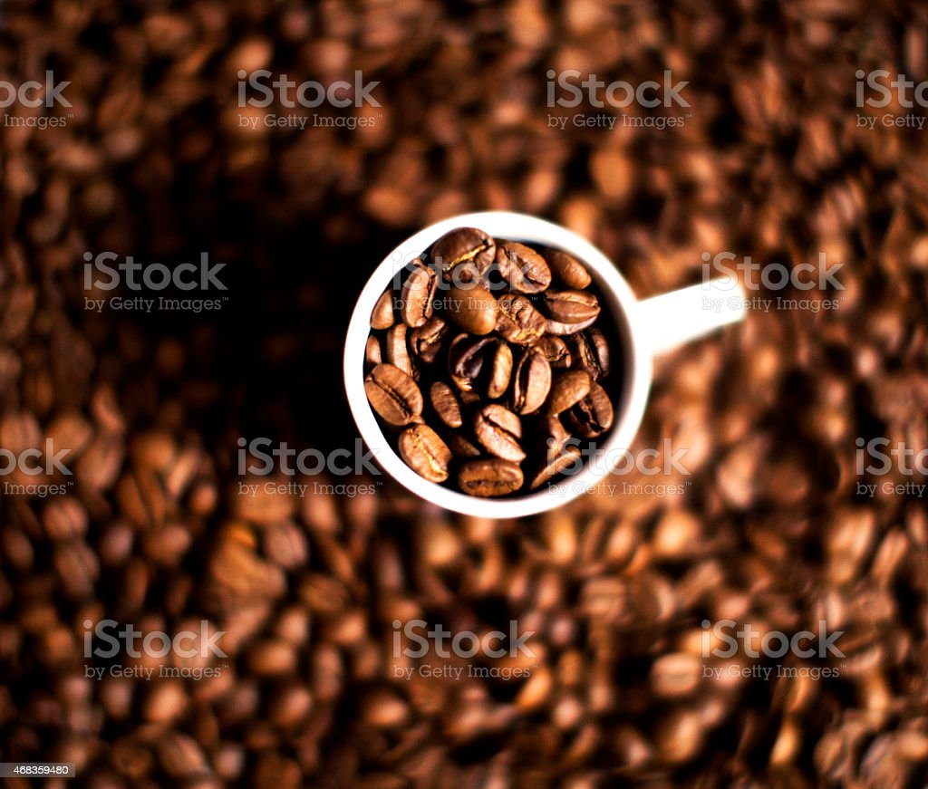 Coffee cup and coffee beans close up. royalty-free stock photo