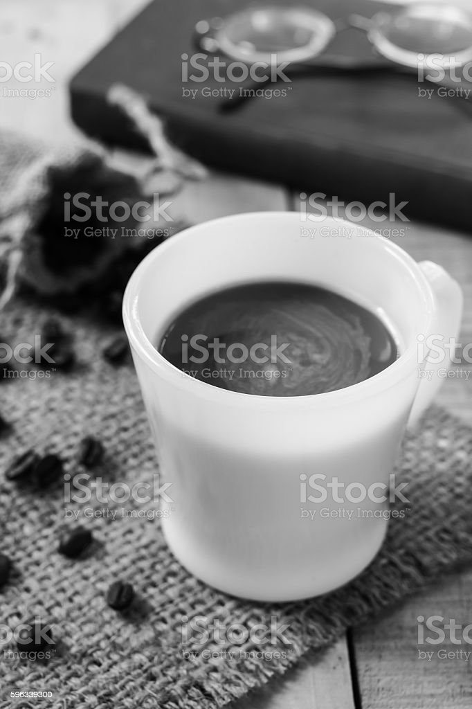Coffee cup and coffee beans on sackcloth mat, selection focus. royalty-free stock photo