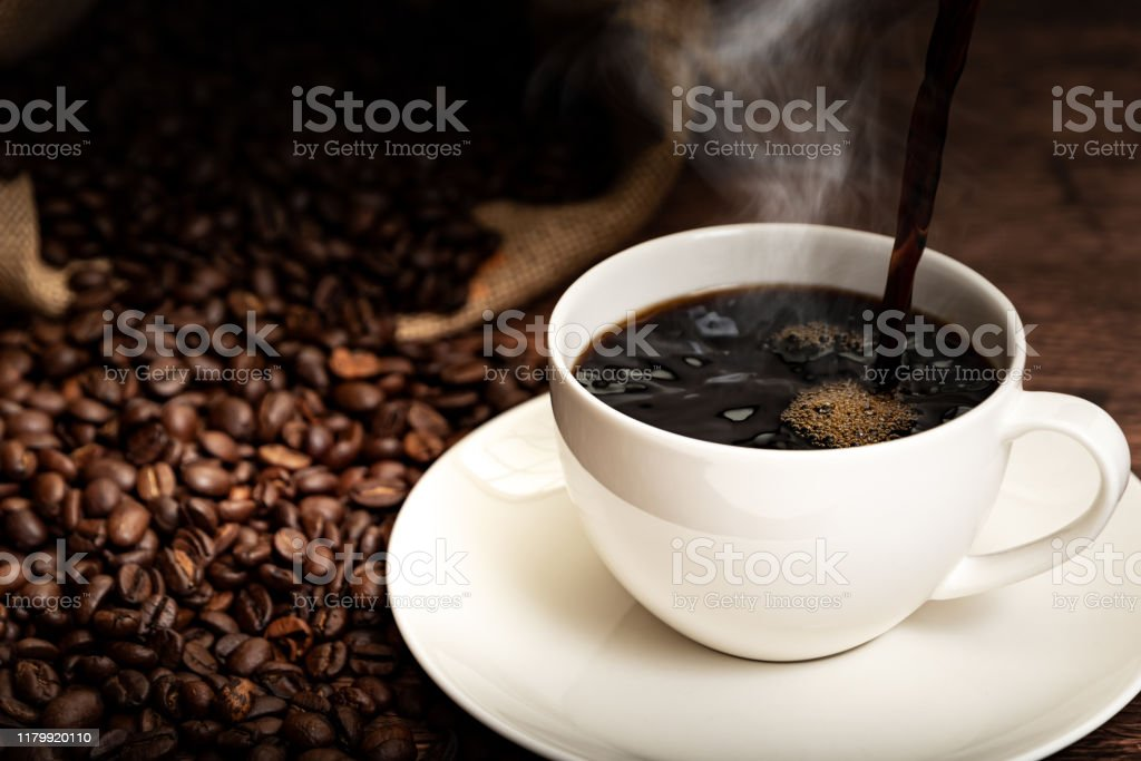 Coffee cup and coffee beans Coffee cup and coffee beans Backgrounds Stock Photo