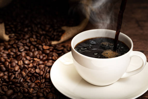 Coffee cup and coffee beans picture id1179920110?b=1&k=6&m=1179920110&s=612x612&w=0&h=jyc5sg3inerrxiwya8md8mafy2sbigpyk0ix sya wq=