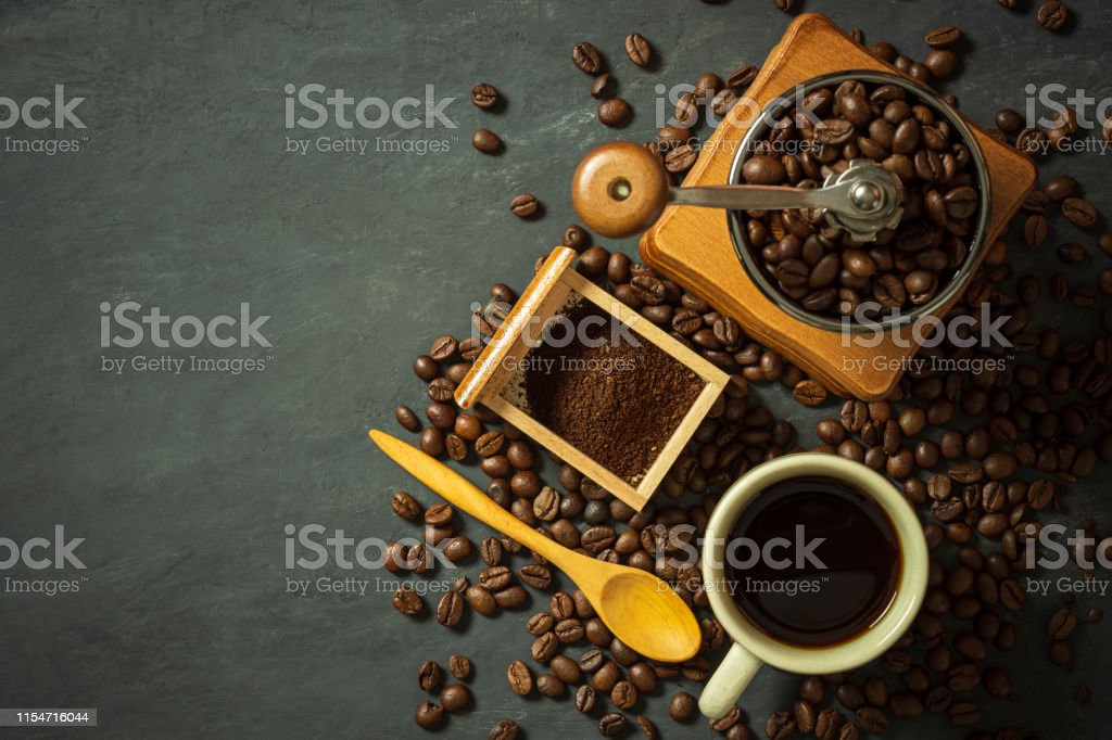 Coffee cup and coffee equipment on black cement floor. Top view and...