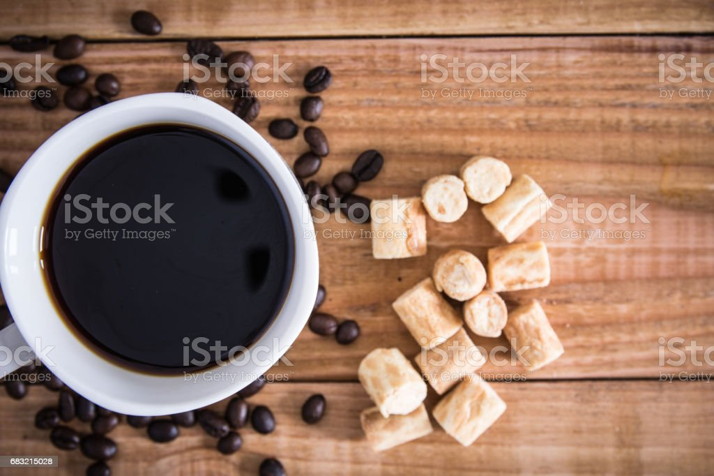 Coffee cup and cookie collon on wooden background. Top view. royalty-free 스톡 사진