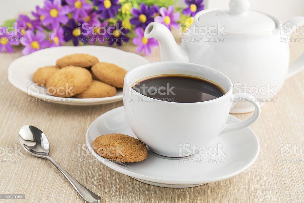 Coffee cup and cookies on table stock photo