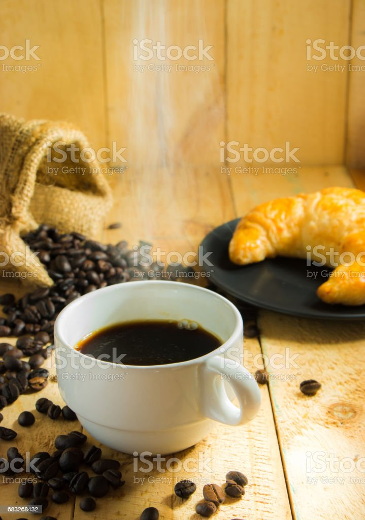 Coffee cup and fresh baked croissants 免版稅 stock photo