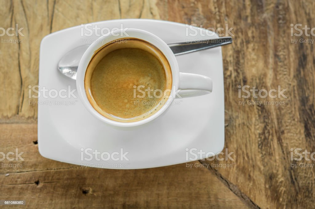Coffee cup and laptop in coffee shop royalty-free stock photo