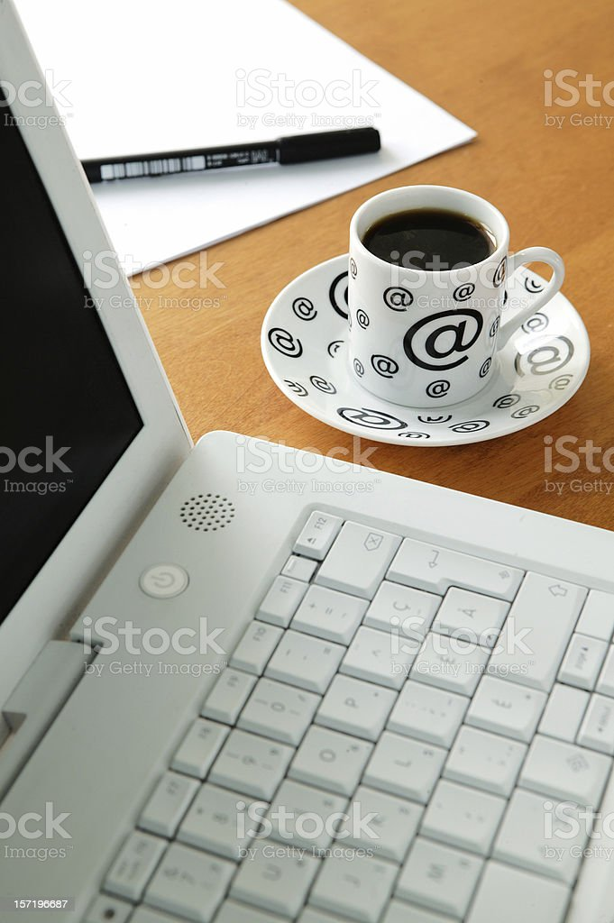 Coffee cup and laptop royalty-free stock photo
