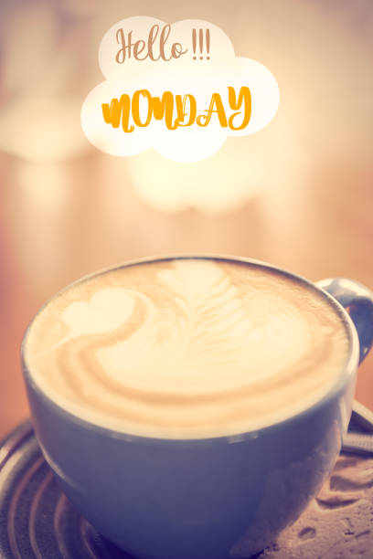 coffee cup and monday text wrote on blurred  background,retro effect - monday motivation stock photos and pictures