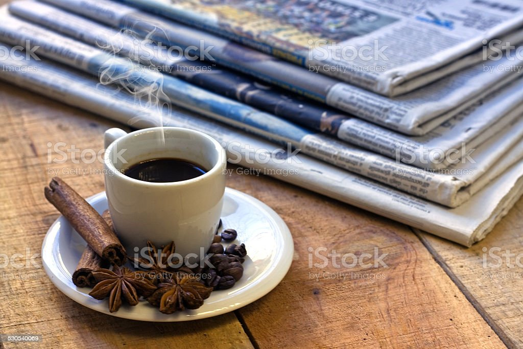 Coffee cup and newspaper stock photo