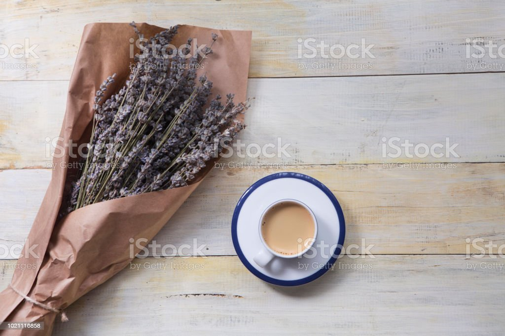 Coffee cup and Provence Dried Lavender on wooden table stock photo