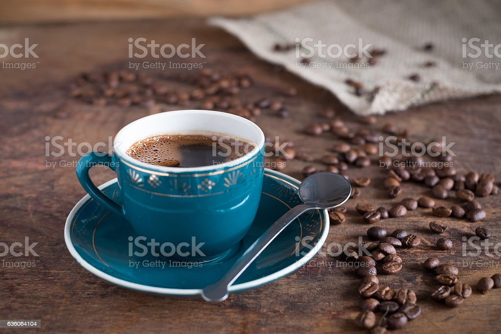 Coffee cup and roasted beans on a wooden background stock photo