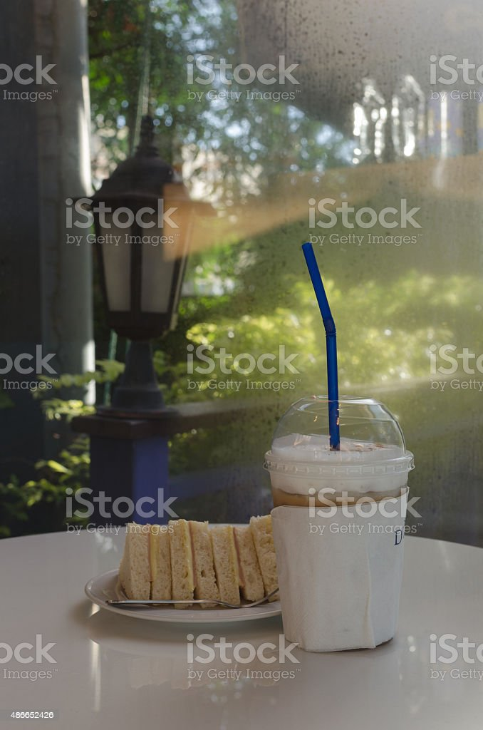 coffee cup and sandwich in the garden stock photo