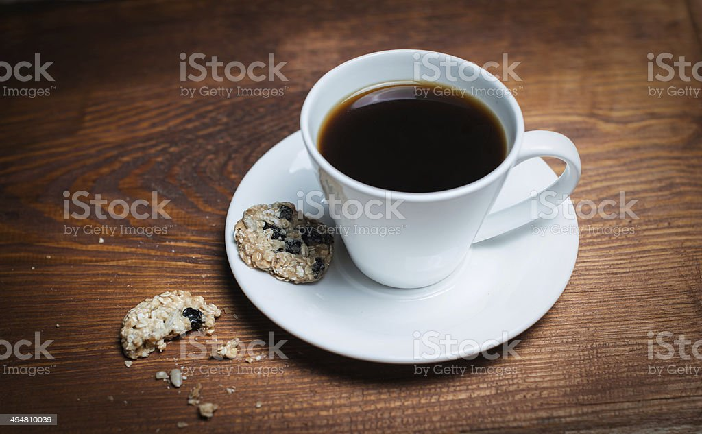 Coffee cup and saucer on a wooden table. Dark background. stock photo