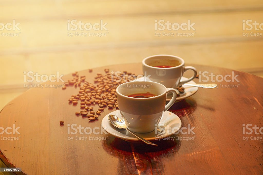 Coffee cup and saucer on a wooden table. stock photo