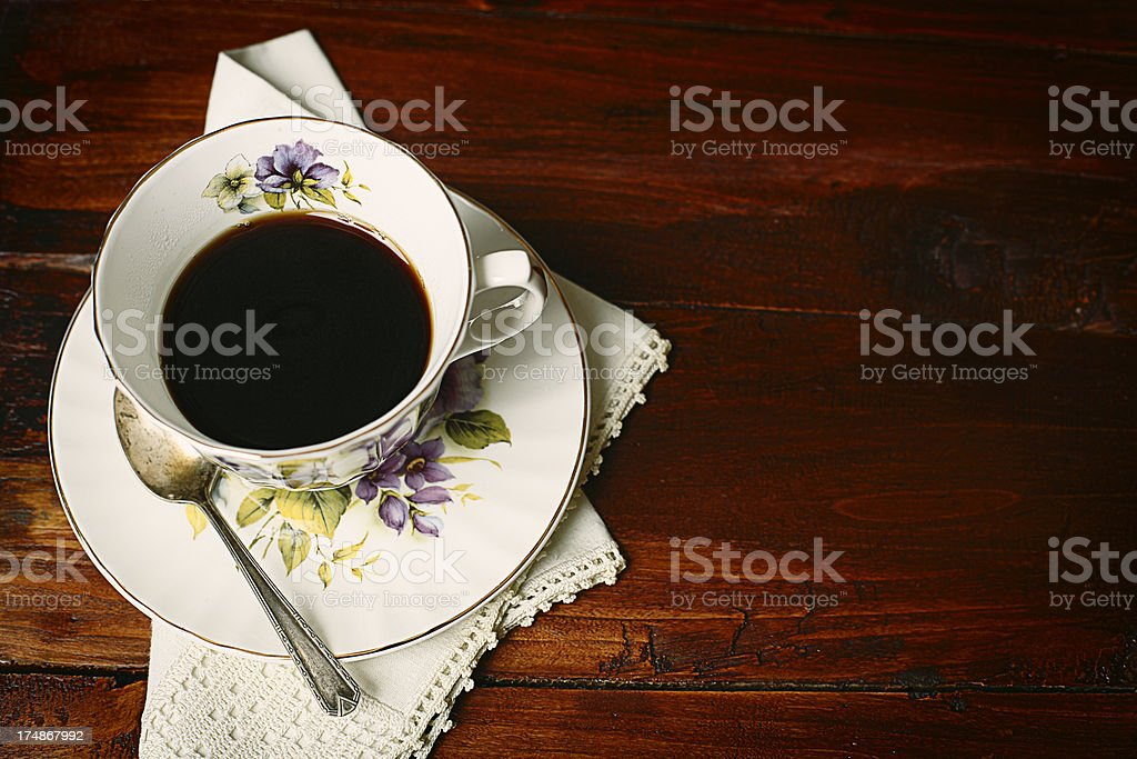 Coffee cup and saucer on wooden tabletop royalty-free stock photo