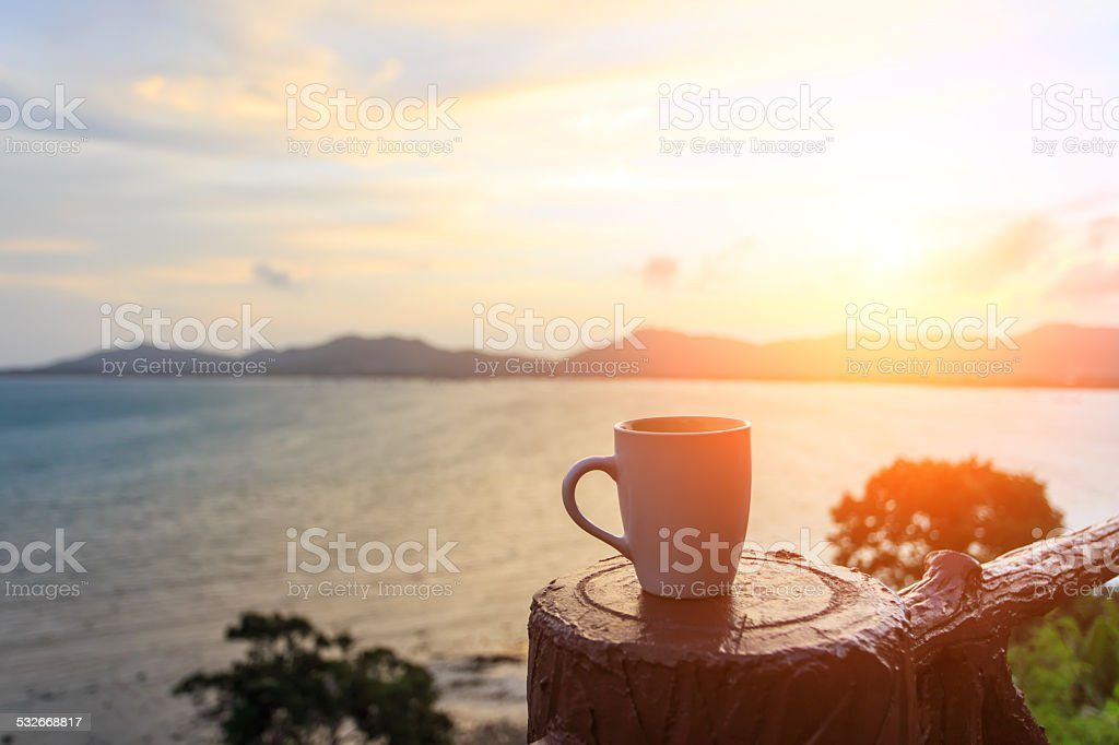 Coffee cup and sutset stock photo