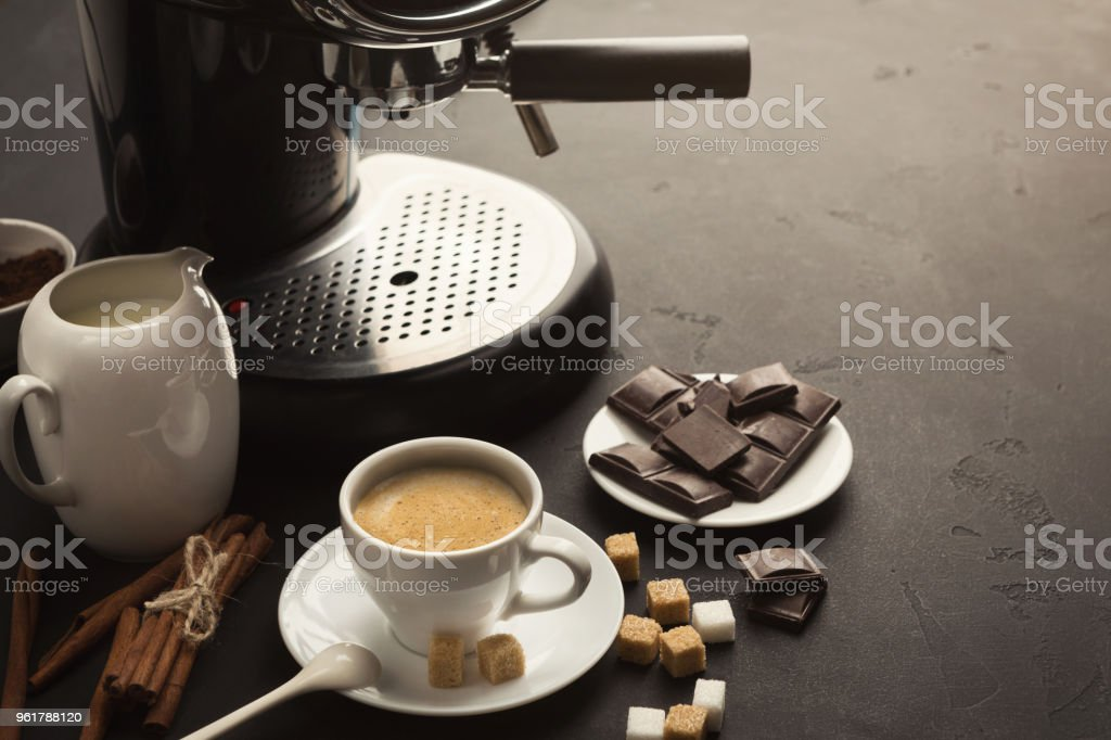 Coffee cup and sweets on black table stock photo