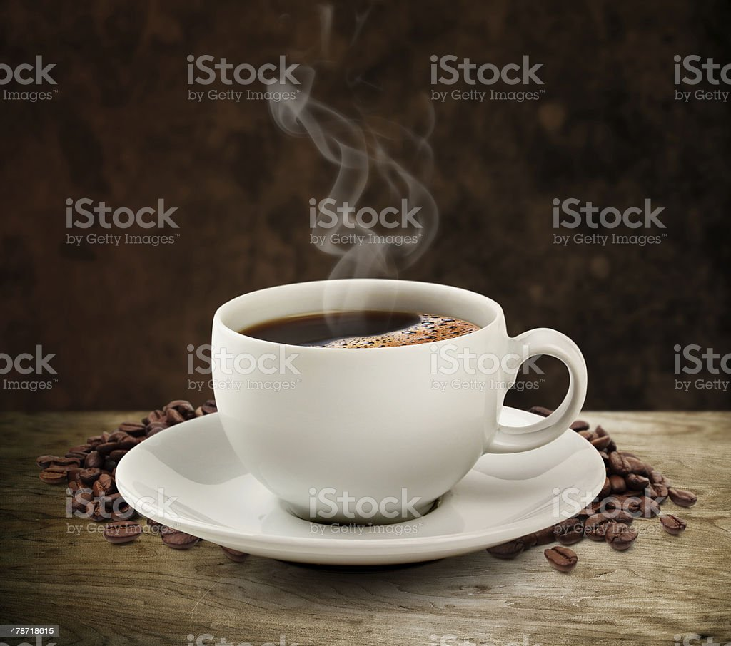Coffee cup and wooden table dark background (clipping path). stock photo