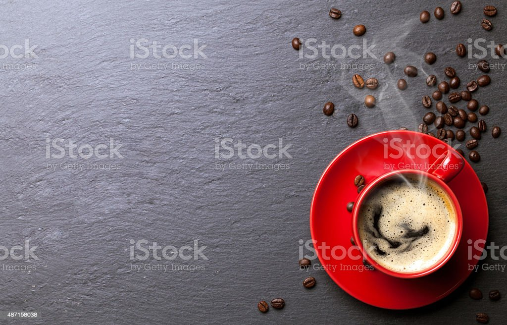 coffee cup background with coffee beans stock photo