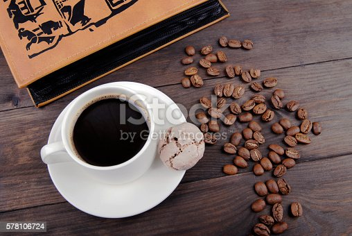 istock Coffee cup, beans and book 578106724