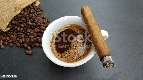 istock Coffee cup, beans and cigar 871504938