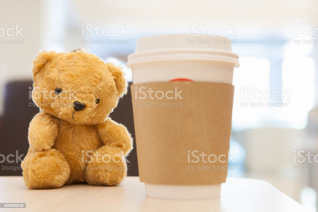 Coffee cup, blurred on teddy bear face royalty-free stock photo