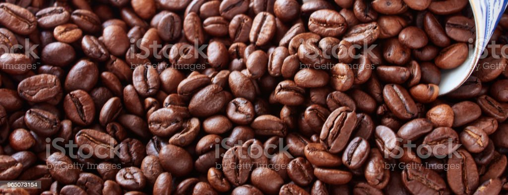 Coffee cup from thin porcelain against the background   grains. royalty-free stock photo
