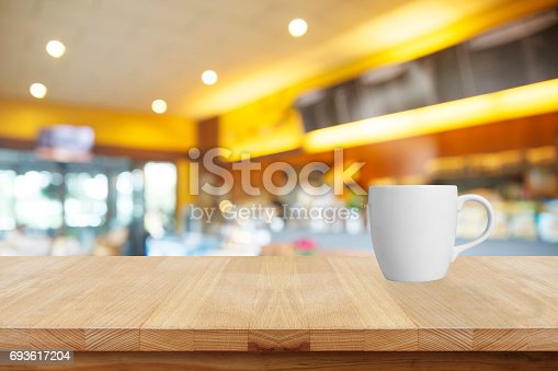 istock Coffee cup in coffee shop 693617204