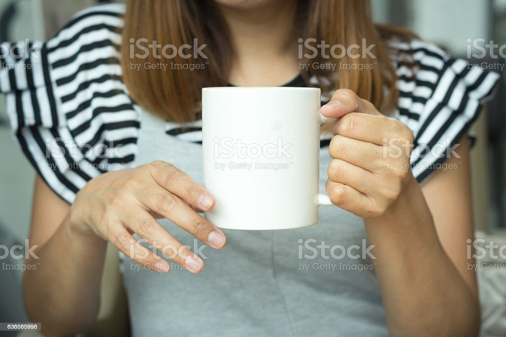 Coffee cup in woman hand stock photo