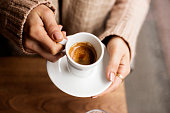 istock Coffee Cup, Lady's hands holding Coffee Cup, Woman holding a white mug, Espresso in white cup 1225614709