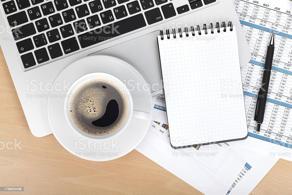 Coffee cup, laptop and notepad royalty-free stock photo