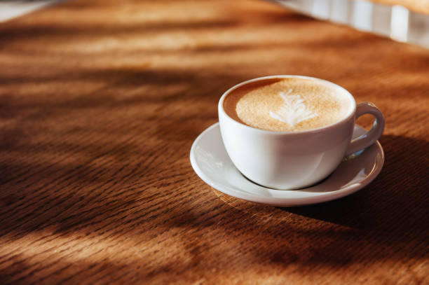 coffee cup latte art in cafe stock photo